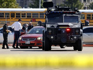 Police officials work the scene of a school shooting at Mansfield Timberview High School in Arlington, Texas, Wednesday, October 6, 2021. Four people were injured inside the school and transported to area hospitals. The shooter is still at-large. (Tom Fox/The Dallas Morning News)