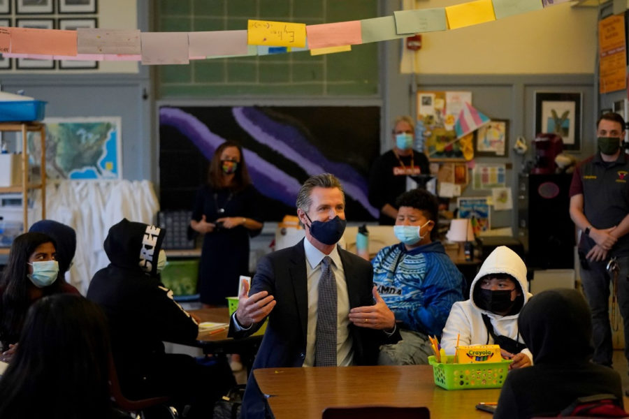 Gov. Gavin Newsom speaks to students in a seventh grade science class in San Francisco on Oct. 1, 2021.